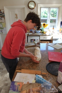 Kate rolling the bread...